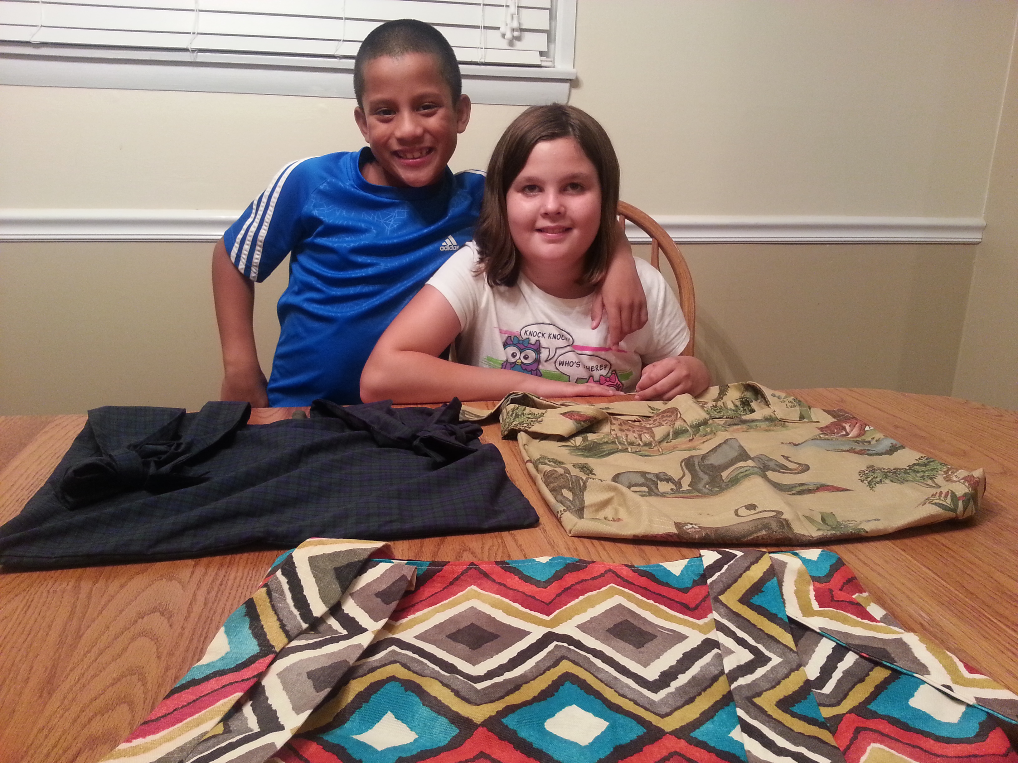 Madeline and her brother Sam with 3 wheelchair Buddee Bags