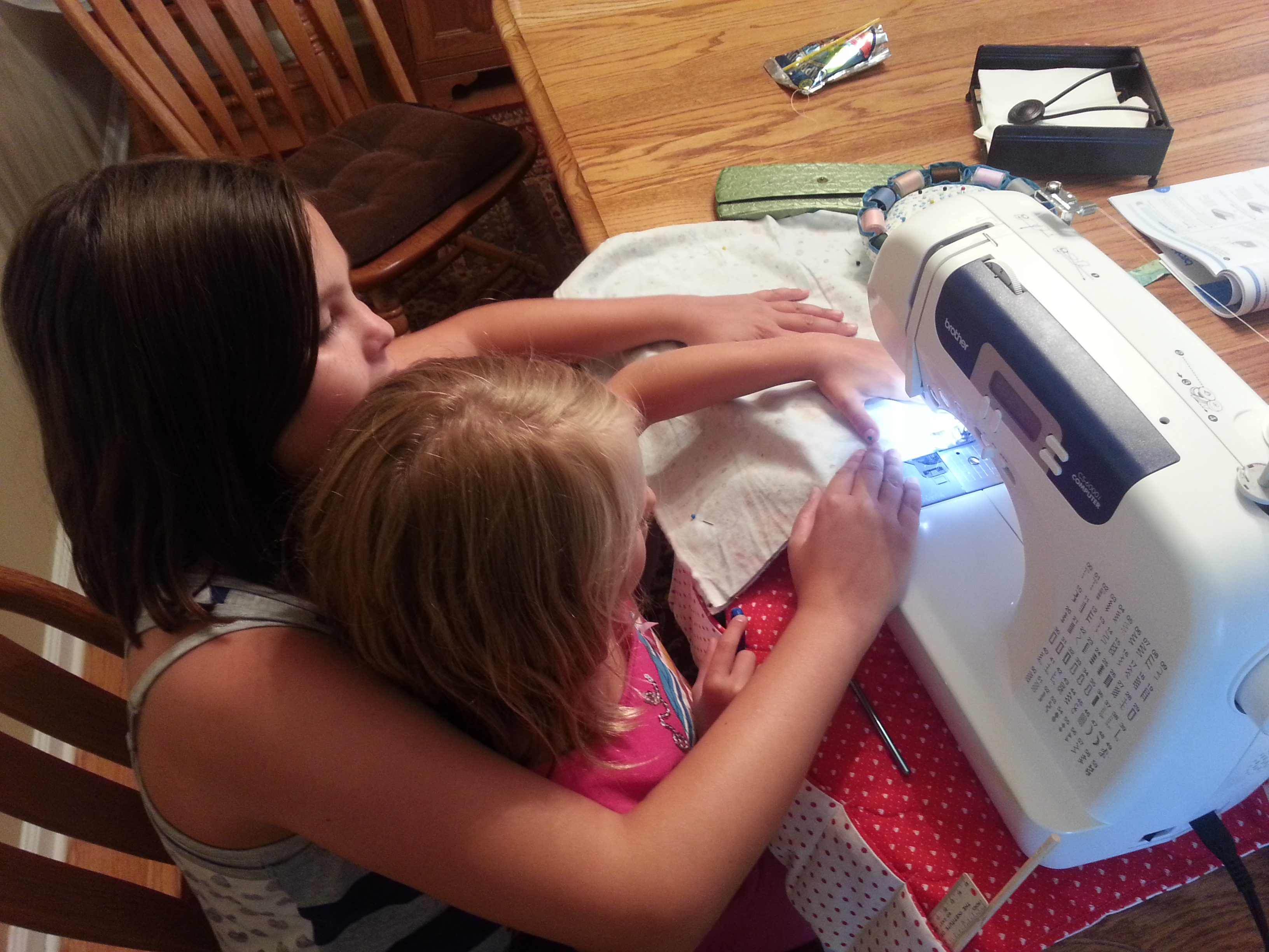 Another photo of me teaching my other cousin how to sew