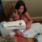 Me teaching my other cousin how to sew