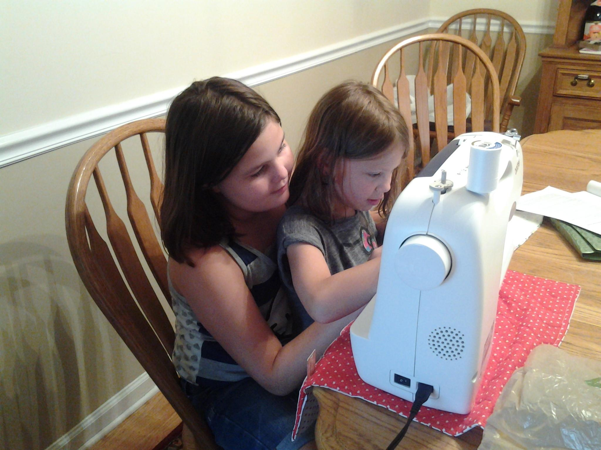 Me teaching my cousin how to sew